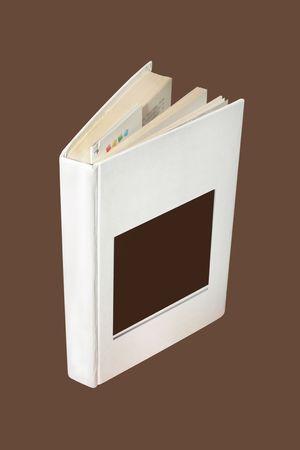 oldened: book under brown background