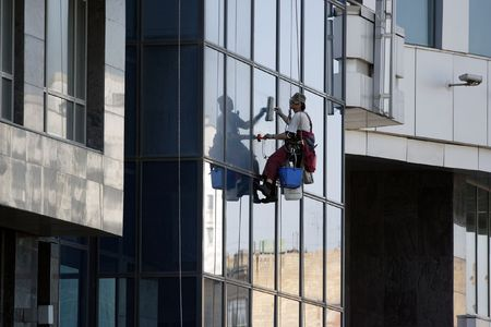 steeplejack: The steeplejack washes windows of a high-rise building Stock Photo