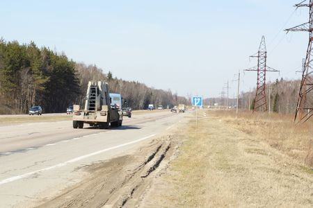 demarcation: The  highway with wood on roadsides Stock Photo