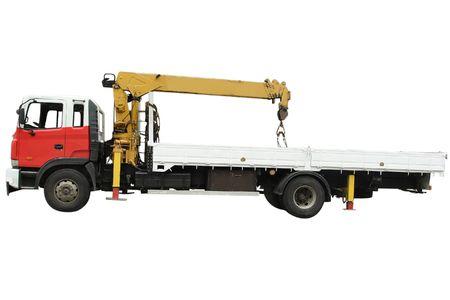 camion grua: Cami�n con el manejador en el marco del fondo blanco Foto de archivo