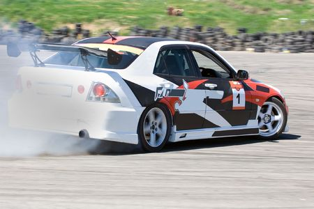 exhaust: Racing car during the race Editorial