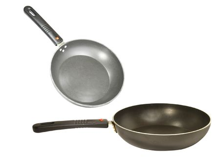frying pans under the white background photo