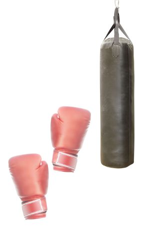 punching bag and red mitts under the light background photo