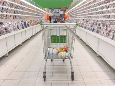 The image of shopping trolley with  purchase. Focus is under the front part of trolley photo