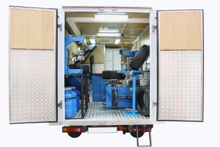 tire fitting: The image of mobile tire fitting shop under the white background