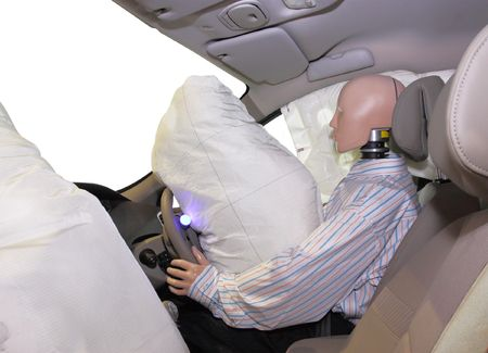 The image of mannequin in a car after crash-test photo
