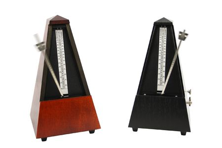 The image of metronomes under the white background photo