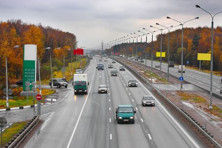 demarcation: The image of automobiles drives under a highway