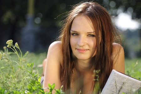 Th image of a girl lies on the grass Stock Photo - 10051372