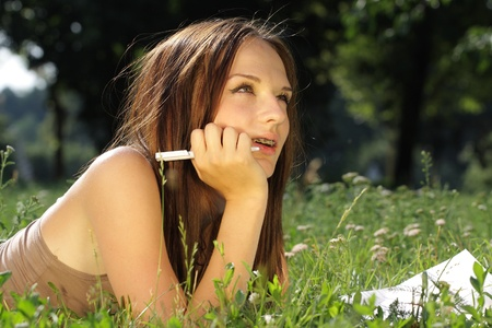 The image of a girl on a grass Stock Photo - 10051373