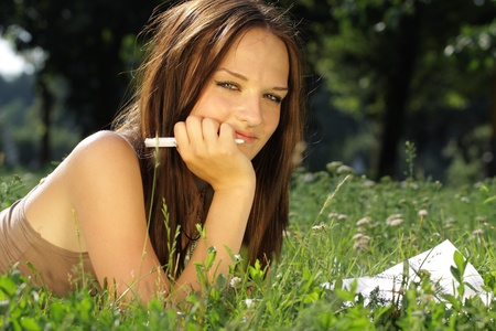 The image of a girl lies on a grass Stock Photo - 10051371