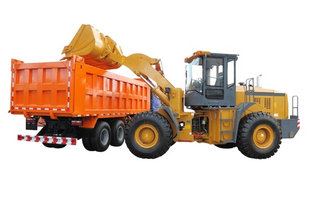 loads: The image of wheel tractor-loader loads the truck