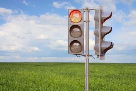 with light shadow: The image of traffic light stans under the meadow Stock Photo