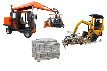 The image of a forklifts near the bricks on a pallet photo