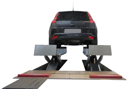 repair shop: The image of a car on the lift isolated under the white background
