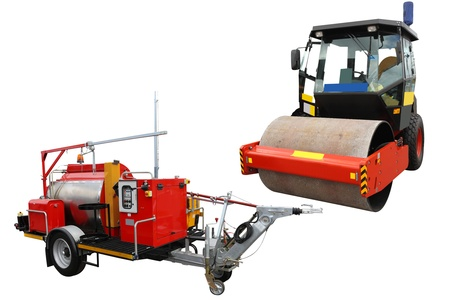 road roller and traffic lane markings machine under the white background photo