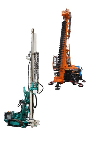 The image of a drilling machine and a pile driver under the white background photo