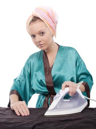 The image of ironing girl under the white background photo