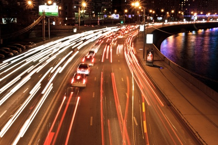 The image of night traffic jam on city embankment in Moscow photo
