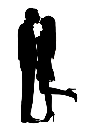 silhouettes of stuck on couple under the white background photo
