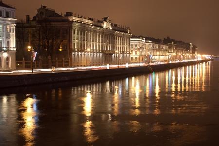 The image of night traffic jam on city embankment