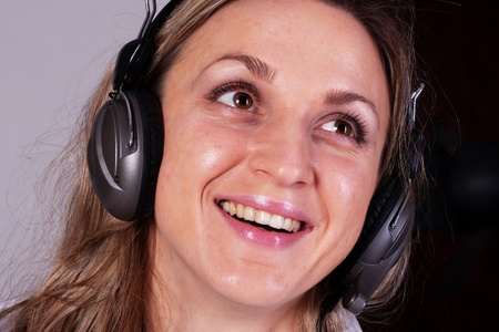 The image of girl with earphones Stock Photo - 12127247