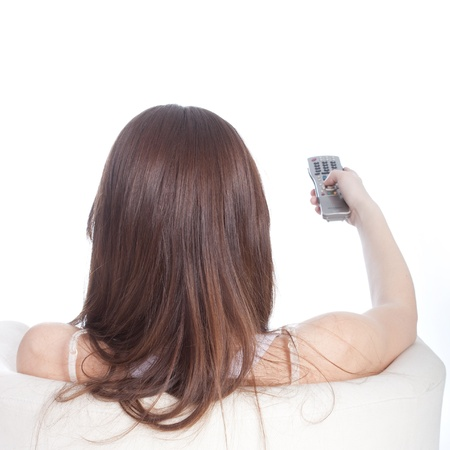 The image of girl with a remote control.  View from behind photo