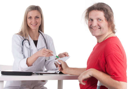 Woman doctor makes a medical examination for a man Stock Photo - 12629657
