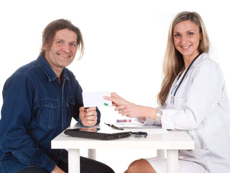 Woman doctor makes a medical examination for a man Stock Photo - 12629662