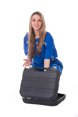 acute care: The image of an emergency woman doctor in the blue suit with a bag Stock Photo