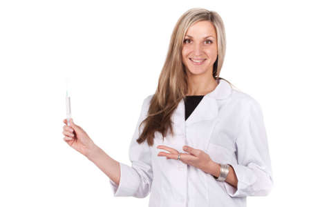 Woman doctor brings syringe and shows to it photo