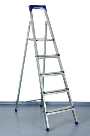 stepladder: stepladder stands near a white wall