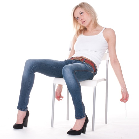 addict: addict woman sits unconscious on the chaire
