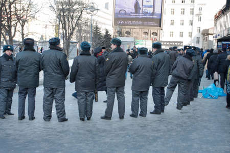 downtrodden: MOSCOW - March 10  Police cordon on a participants of the protest manifestation against falsification of the president election, Noviy Arbat in Moscow  March, 10, 2012 in Moscow