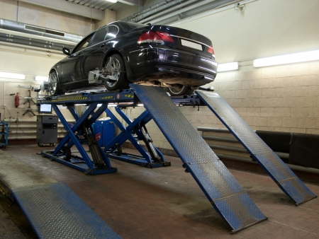 chassis: The car on the lift in a repair garage Stock Photo