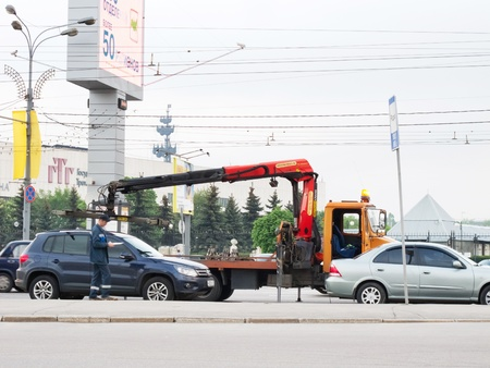 MOSCOW - MAY 9, 2012: Wrecker tows away wrongly parking cars in Moscow on May 9, 2012