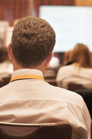 The audience listens to the acting in a conference hall Stock Photo - 14047764
