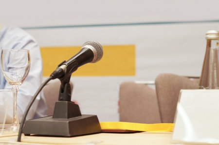 pres: microphone on a panel table