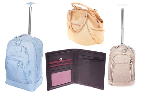 purse, suitcase and ladys bag under the white background photo