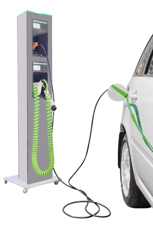 charging: Hibrid car chargers near the charging station Stock Photo