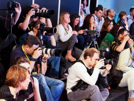 MOSCOW - SEPTEMBER, 5, 2012: Paparazzi photograph the fashion show during the 19-th International Exhibition for Fashionin in Moscow on September 5, 2012