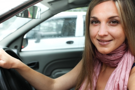 Girl in a car on a driver's place photo