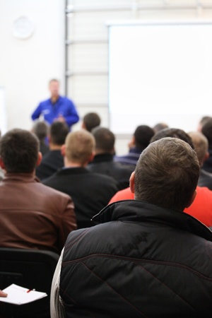 classroom training: The audience listens to the acting in a conference hall.