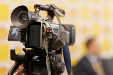 The image of video camera under the tripod Stock Photo - 15941228