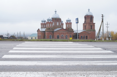 The image of a church near the road photo
