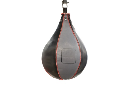 punching bag under the light background photo