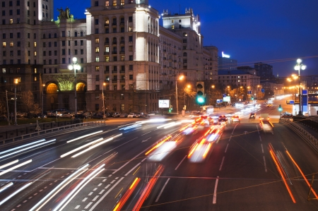 autobahn: night traffic on city embankment in Moscow