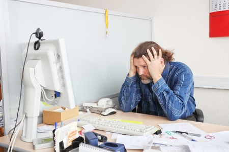 Office employee works on his working place Stock Photo - 17194182