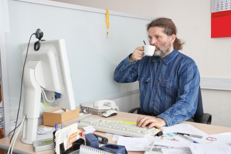 Office employee works on his working place Stock Photo - 17194183