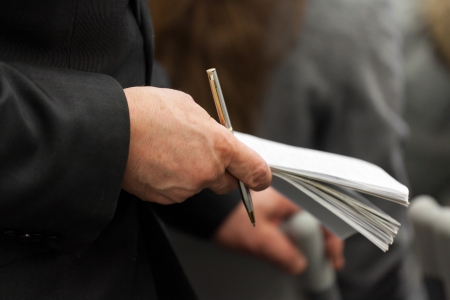 Hand of an elderly businessman and note-book in it Stock Photo - 17728657